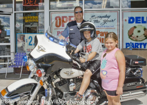 Officer Riss with Dylan Walton (on motorcycle) and Mya Marcicky.