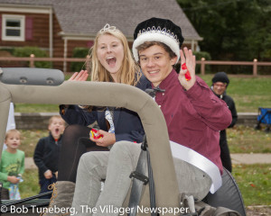 Bay homecoming king and queen Michael Randazzo and Hannah Goebel greet the crowd during Friday's homecoming parade.