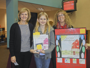 Cathy Fischer, gifted supervisor Educational Service Center of Lorain County; Katherine Danielson, Young Illustrator winner; and Catherine Brady, fourth-grade teacher, Eastview Elementary School. Credit – Avon Lake City Schools