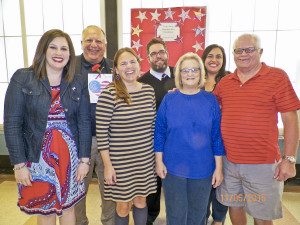 """Holly Lane Music Teacher Mrs. Alison Gregory at the front left and her family of military veterans and supporters including Mrs. Gregory's brother Marine Corps Veteran Mr. Chris Martin in the center of the back row who sang the """"Star Spangled Banner"""" at Holly Lane's Veteran Assembly."""