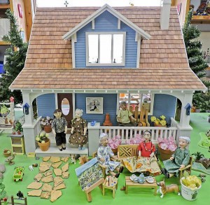 "Vicki Elliott Miller's Hittyville Crafters was inspired by Baycrafters... ""Sally Price and I are on the front porch steps surrounded by Beatrix Potter, Grandma Moses, Frida Kahlo, and Tasha Tudor. Sally's spirit lives on."""