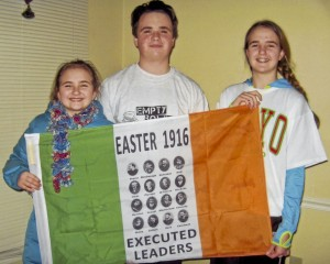 Kate, Tommy & Ellen Lavelle holding the flag sent from Ireland.