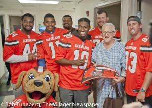 Football season is still a few months away, but members of the Cleveland Browns scored big time at UH St. John Medical Center in Westlake when they stopped by for a visit Tuesday. They are seen here with patient Henry Grendell of North Olmsted, who is surrounded by (from left) Nate Orchard, Terrelle Pryor, John Hughes, III, Robert Griffin, III, Joe Thomas and Brian Hartline.