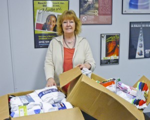 Denise Toth, Outreach Worker, Northeast Ohio Coalition for the Homeless with the 220-plus pairs of socks collected at the Girl Scout Troop 70421 Sock Hop.