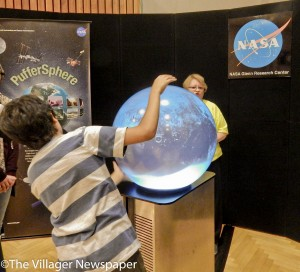 "One of the many attractions for guests to explore was an Earth ""PufferSphere"" globe that displays recent data from NASA's Earth-orbiting satellites."