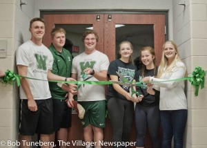 Students (l-r) Mike Beaver, Jack Redinger, Justin Godfrey, Melanie Rence, Kelley Moutoux and Rebecca Blair did the ribbon-cutting honors as Westlake High's new weight room opened last week.