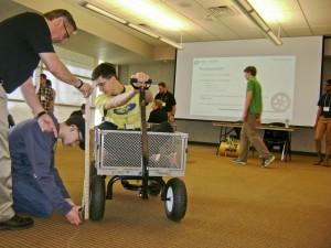 Goodyear STEM Career Day 2016 - David Eppele tests tire pressure in cart-1