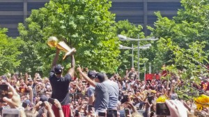 Cavs players hold up the Larry O'Brien Trophy during the parade.