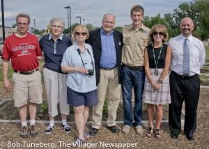 Community Garden committee member Dan Norris, Sr. Judy Wierick, Regina McCarthy, Mayor Clough, Eagle Scout Matt Castele, Madeline Crandall and UH SJMC President Robert David.
