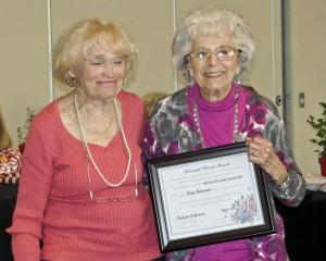 Diane Ruma presents the award to Elsie Pobinson.