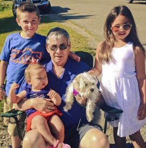 Tom Moran with his grandchildren and late dog, Charlotte.