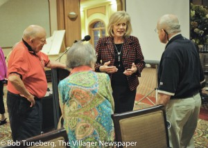 Mayor Bobst speaks with Normandy residents after her 2016 State of the City address.