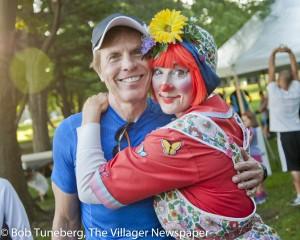 Celebrate Westlake founder Bud Hagy gets a hug from Skipper the Clown.