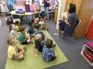 Kourtney Sladek reading to children