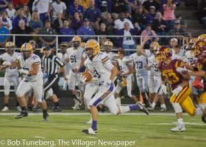 Avon High Senior Mitch Cooper gains big ground in the Eagles win over Avon Lake.