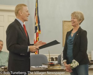 Bay Village Law Director Gary Ebert presents retiring Mayor Debbie Sutherland with a proclamation honoring her years of service at Monday's City Council meeting.