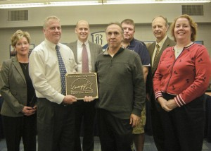 Bay Village Schools are presented with the Energy Star Building Label for Bay High School. Pictured left-to-right: Gardiner associates Lora Atherton, Ted Bedell and Jim Wajciechowski; Bay Village Schools Assistant Superintendent of Operations Daryl Stumph, Buildings and Grounds Supervisor Dave Newsome, Superintendent Clint Keener and Board of Education President Amy Huntley.