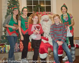 Santa and his Elves take gift requests at Avon Isle.