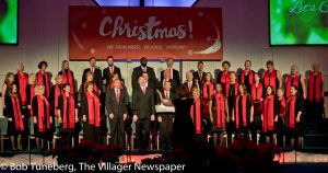 Director Robin Nichols leads the Christian Heritage Church Choir in this year's Christmas Canta-ta held Dec. 3-4.