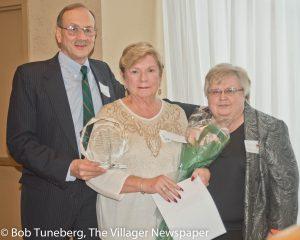 Ardis and Bill Radak, honored by incoming SJMC Auxiliary President Joyce Holod.