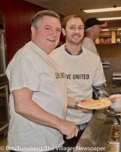 Edwin Oley, Senior Vice President for Mercy Health and Regional CEO of the Mercy Lorain Region and Lorain Mayor Chase Ritenauer were guest servers at the United Way of Lorain County Pancake Breakfast.