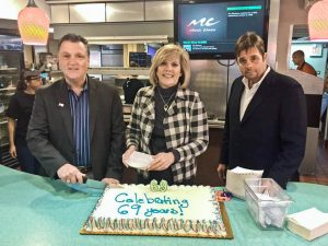 Owner Jim Griffiths, Rocky River Mayor Pam Bobst and Doug Walters helped kick off the event by cutting some cake.