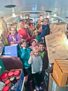 Westlake students ready to unload donations from school bus for May Dugan Center.