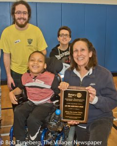 "When Youth Challenge Executive Director Mary Sue Tanis received the Rotary Lifetime Achievement Award Saturday, she immediately posed for a photo with volunteers Sam Weiss and Adam Philipps along with client Jaylin Washington. ""This award is really about them,"" said Mary Sue."
