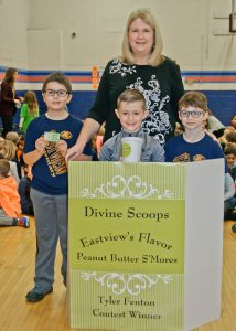 Eastview Ice Cream contest finalists (L to R) Nathan Kohlia, Tyler Fenton and Sawyer Costin with Divine Scoops owner Arlene Jaroscak.