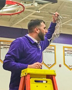 Avon High basketball coach Kevin Sapara cuts down the nets after the Eagles clinched the SWC title two weeks ago.