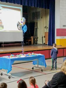 The first-grade students took turns reading their page to parents.