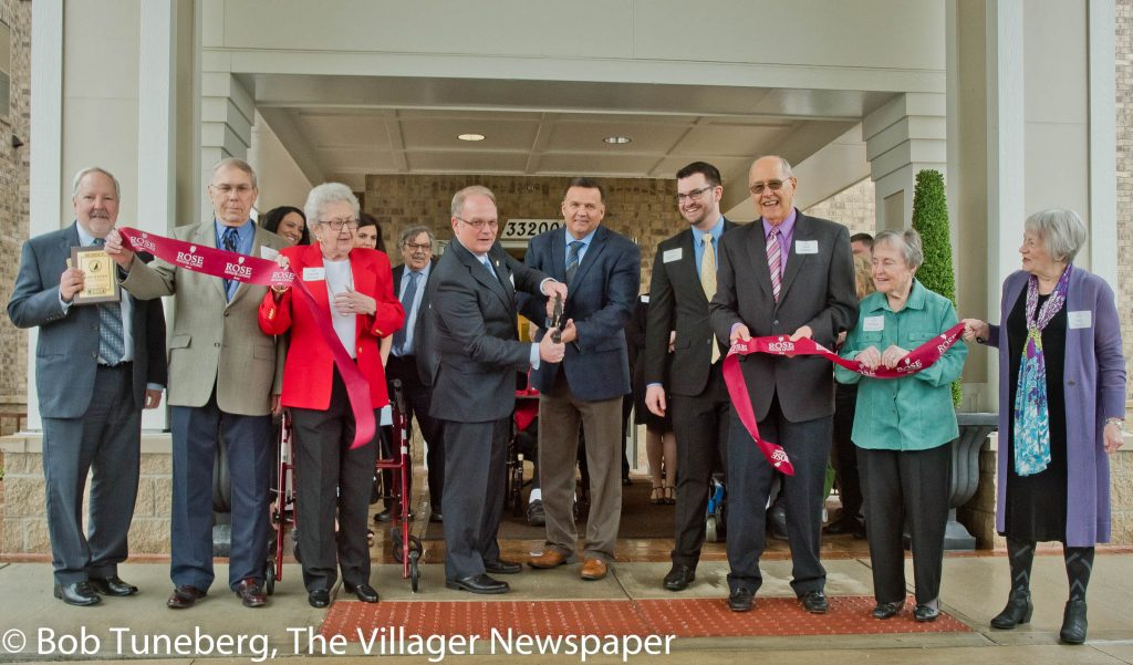 Avon Mayor Bryan Jenson (center) joined with Warren Rose, CEO Edward Rose & Co. at Friday's ribbon cut-ting at the new Rose Senior Living Health Campus. They were joined by residents, Chamber members and other dignitaries for the festive event.