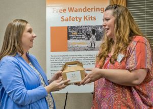 Alison Smith receives a Wandering Safety Kit at the Meet and Greet from Julie Merda, Connecting for Kids Program Assistant.