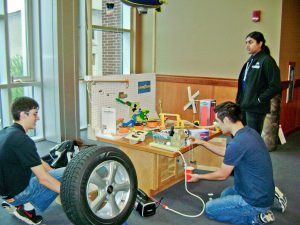 Rube Goldberg 2017 - David Eppele Mark Sargent Sneha Ramachandran setting up machine-1