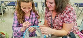 Students Knitting Items to Help the Homeless